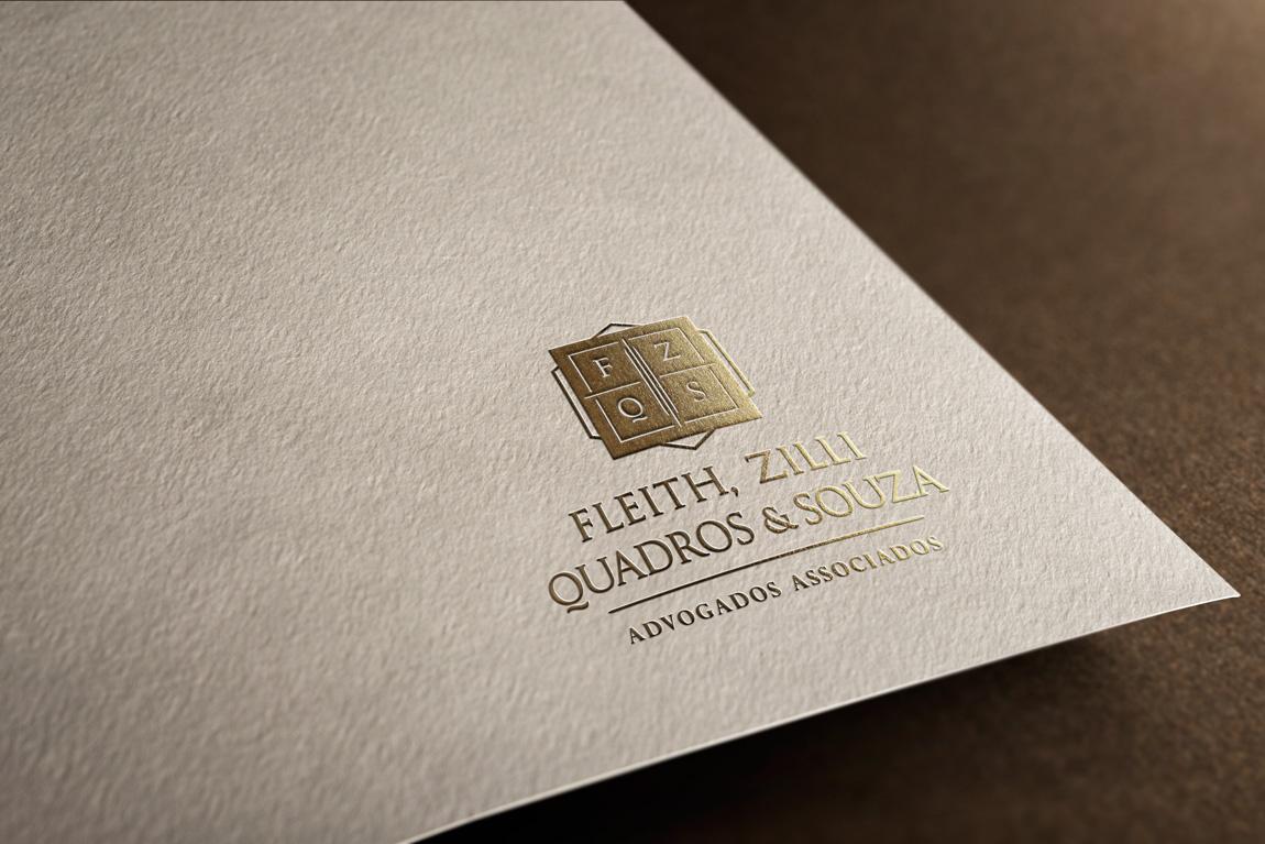 Detalhe do logotipo aplicado em tinta ouro, no processo de hot stamping, no papel timbrado para o escritório FZQS advogados de São Paulo